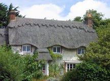 Cabaña cubierta con paja Imagen de archivo libre de regalías