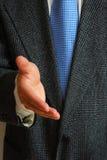 Caballero con su mano a invitar o el apretón de manos Fotos de archivo