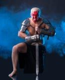 Caballero con una espada Foto de archivo libre de regalías