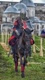 Caballero Jousting On Horseback fotografía de archivo