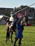 Caballero Jousting On Horseback fotografía de archivo libre de regalías