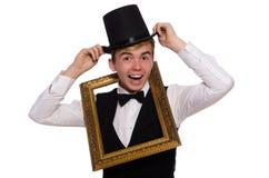 Caballero joven que lleva a cabo el marco aislado en blanco Fotografía de archivo libre de regalías