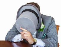 Caballero que oculta su cara Imágenes de archivo libres de regalías