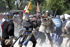 Caballeros medievales usados en batalla Fotos de archivo libres de regalías