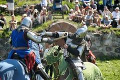 Caballeros que luchan a caballo Foto de archivo libre de regalías