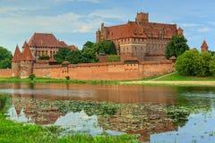 Caballeros teutónicos en el castillo de Malbork en verano Foto de archivo libre de regalías