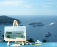 Caballete con una bahía de la pintura de la acuarela de Mónaco Imagen de archivo