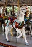 Caballo blanco del carrusel Foto de archivo libre de regalías