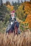 Caballo-caza con los jinetes en hábito de montar a caballo Imágenes de archivo libres de regalías