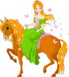 Caballo de montar a caballo de la princesa. Resorte Foto de archivo libre de regalías