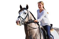 Caballo de montar a caballo feliz de la muchacha en el fondo blanco Imagenes de archivo