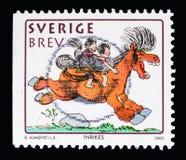 Caballo de montar a caballo de los niños, Año Nuevo chino 2002: Año del caballo Foto de archivo libre de regalías