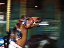 Caballo del carrusel en el movimiento Fotografía de archivo