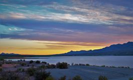 Caballo Lake Pink Sunset. The Caballo Mountains silhouette against the southwest sky behind Caballo Lake in southern New Mexico stock photos