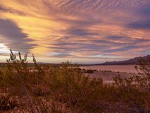 Caballo Lake Pink Sunset. The Caballo Mountains silhouette against the southwest sky behind Caballo Lake in southern New Mexico stock image