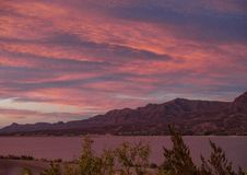 Caballo Lake Pink Sunset. The Caballo Mountains silhouette against the southwest sky behind Caballo Lake in southern New Mexico stock photo
