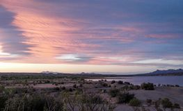 Caballo Lake Pink Sunset. The Caballo Mountains silhouette against the southwest sky behind Caballo Lake in southern New Mexico royalty free stock photography