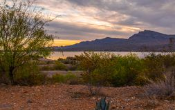 Sunset over Caballo Lake in New Mexico. The Caballo Mountains silhouette against the southwest sky behind Caballo Lake in southern New Mexico stock photo
