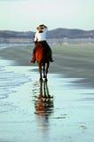 Caballo y jinete en la playa Imagen de archivo libre de regalías