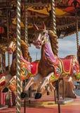 Caballos coloridos del carrusel Imagen de archivo libre de regalías