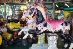 Caballos coloridos del carrusel Fotografía de archivo