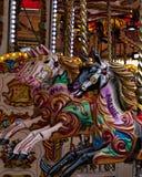 Caballos coloridos locos de un carrusel fotos de archivo libres de regalías