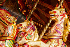 Caballos del carrusel de la feria de diversión Fotografía de archivo libre de regalías