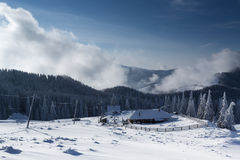 Caban in winter mountain with blue sky Stock Photo