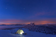 Caban in winter mountain on night Royalty Free Stock Photo