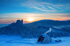 Caban in winter mountain on sunset Stock Images