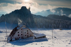 Caban in winter mountain on sunset Royalty Free Stock Photos