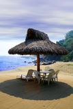 Cabana. Small beach cabana next to sea shore Royalty Free Stock Photography