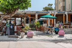 Cabana Bar. PHILLIPSBURG, ST. MARTEEN - JULY 11 - Colorful boardwalk cabana bars with tourists and local people on July 11 2018 in Phillipsburg, St. Marteen royalty free stock photos