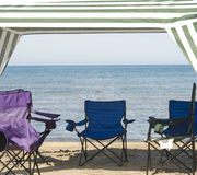 Cabana and chairs. Empty cabana and chairs on beach at edge of lake Stock Photo