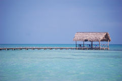Cabana on Ocean Pier. Wooden dock with cabana on a pier Royalty Free Stock Photography