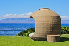 Cabana. Tan wicker round cabana for relaxation and privacy sits on the edge of the coastline in Maui Stock Photography