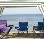 Cabana und Stühle Stockfoto