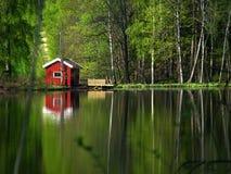 A cabana pequena vermelha Foto de Stock