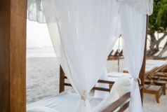 Cabana with White Curtains on a Beautiful Beach in Mexico. Looking out to the Ocean from a Cabana with White Curtains on a Beautiful Beach in Mexico stock images
