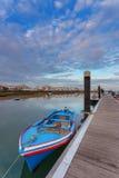 Cabanas łódź rybacka na doku i miasteczko Obraz Royalty Free