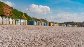 Cabanas da praia em Devon fotografia de stock royalty free