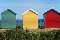 Cabanas da praia em uma frente marítima Fotografia de Stock Royalty Free