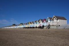 Cabanas da praia, Mersea ocidental, Essex, Inglaterra Foto de Stock