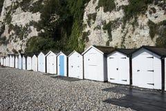Cabanas da praia na cerveja, Devon, Reino Unido. Imagens de Stock