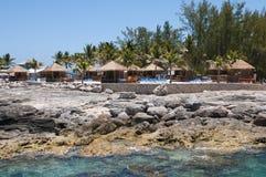 Cabanas em um recife Imagens de Stock