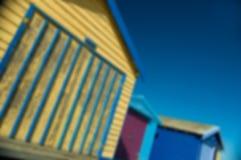 Cabanas rústicas borradas da praia Fotos de Stock Royalty Free