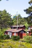 Cabanas rústicas de madeira suecos Imagem de Stock