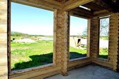 Cabane en rondins, cadre en bois Photographie stock libre de droits