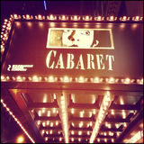 Cabaret on Broadway Sign. NEW YORK - APRIL 2014: Cabaret on Broadway exterior sign in New York City on April 24, 2014. Image taken with an Instagram effect stock photography
