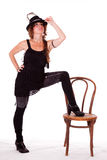 Cabaret dancer posing with leg on chair Royalty Free Stock Photo